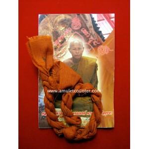 Pha Khod Peun Kram Bor Yan (Knotted Monk Robe Takrut) BE 2554